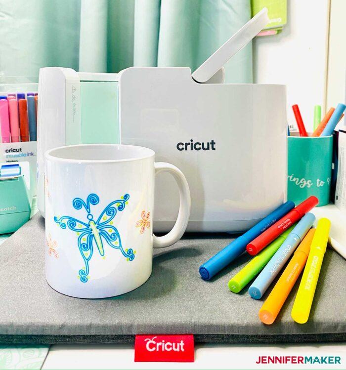 Cricut Mug Press with an Infusible Ink pen mug and markers