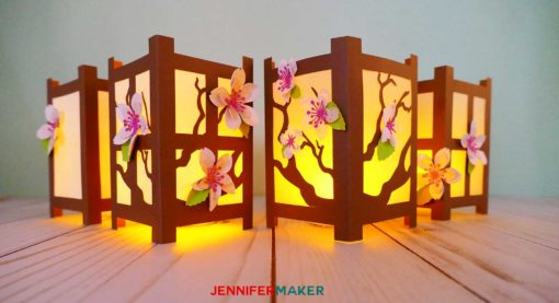 Lit up Japanese Paper Lanterns covered in spring flowers