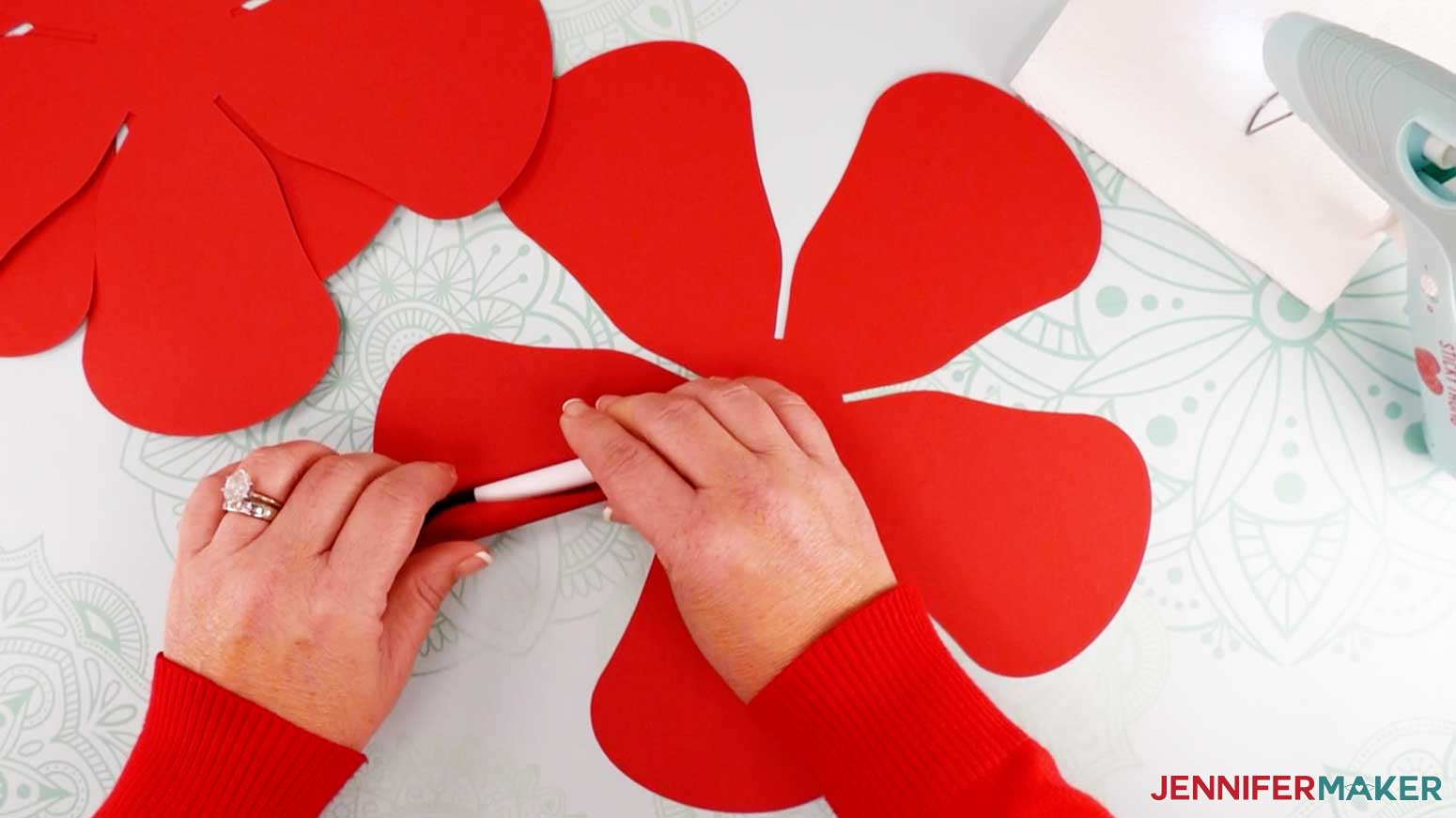 Use a pen or marker to roll the petals of the bud for my giant lace paper flower design
