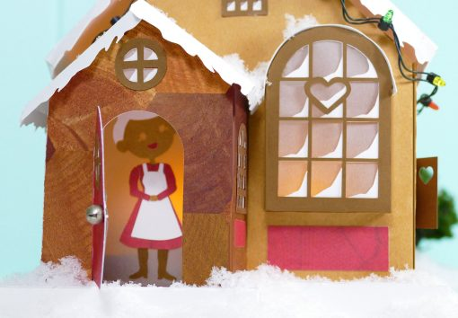 Mrs. Claus inside the Maker Heart Cottage DIY Paper Village