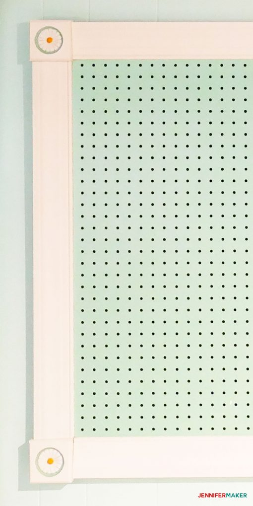 Close-up of large framed pegboard with flower rosettes