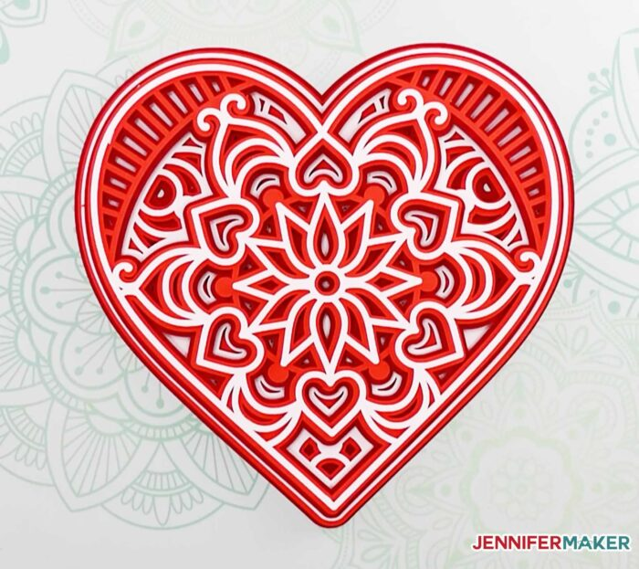 Pretty layered heart mandala made from red, white, and pink cardstock -- free SVG Cut File
