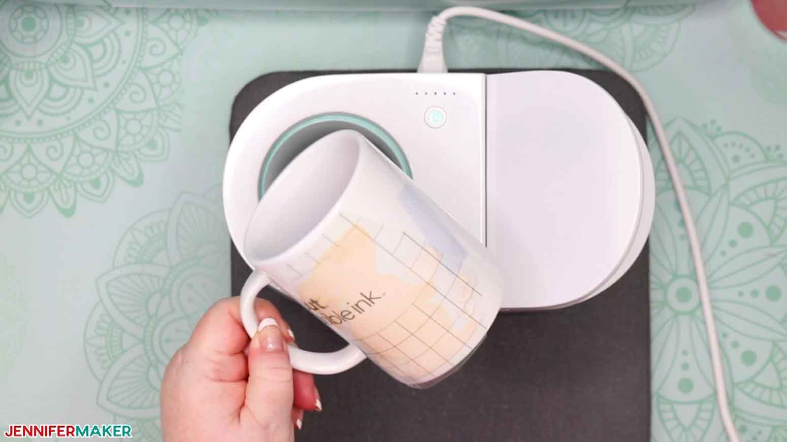 A pressed mug from the Cricut Mug Press with layered Infusible Ink