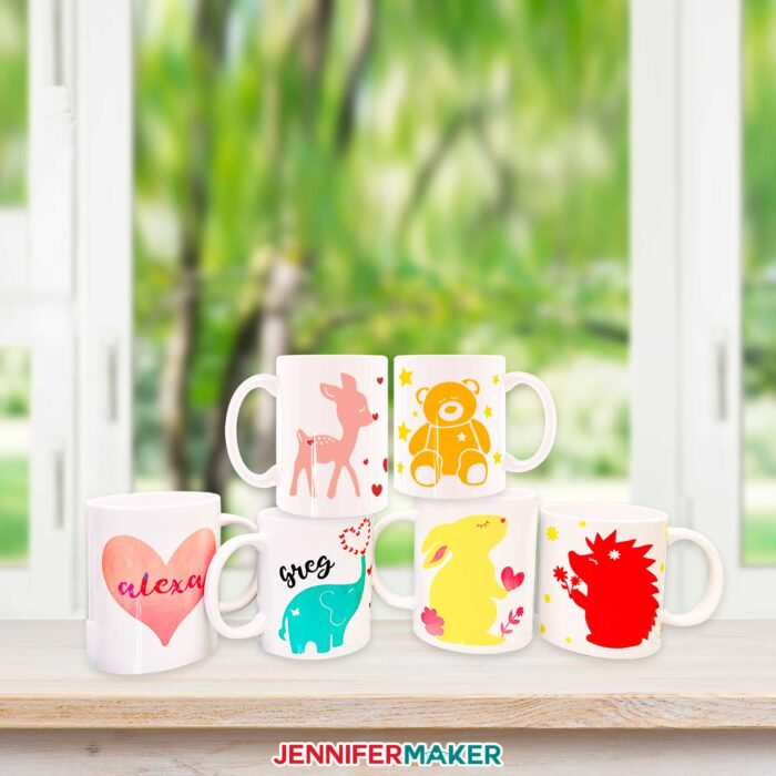 Pretty and colorful layered Infusible Ink mugs on a window sill