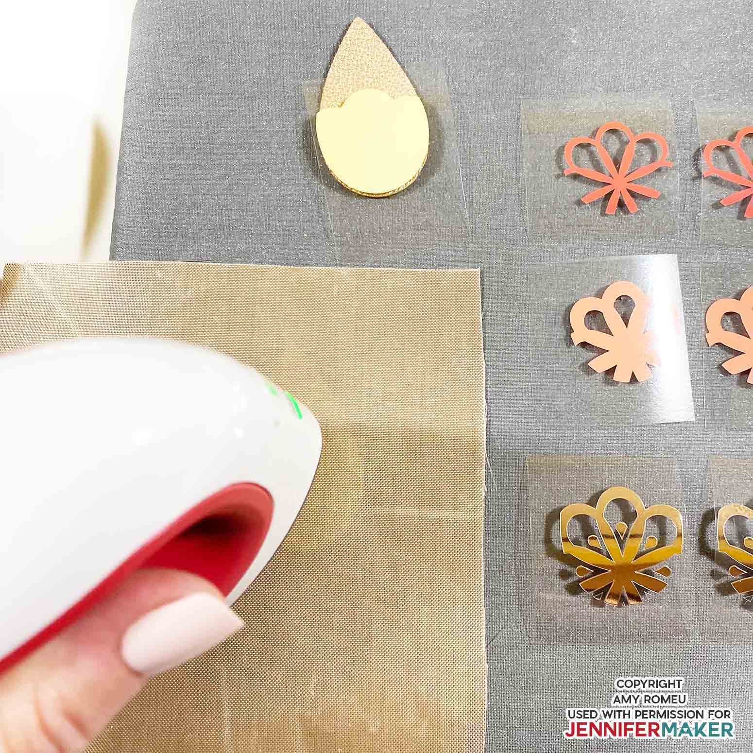heat pressing vinyl earring shape layers onto faux leather