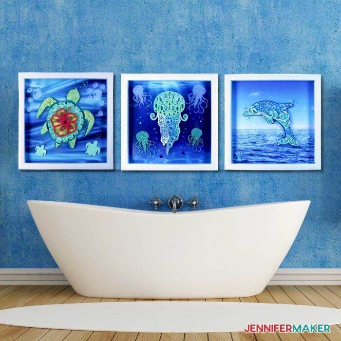 Layered sea animal mandalas framed on the wall above a bath tub