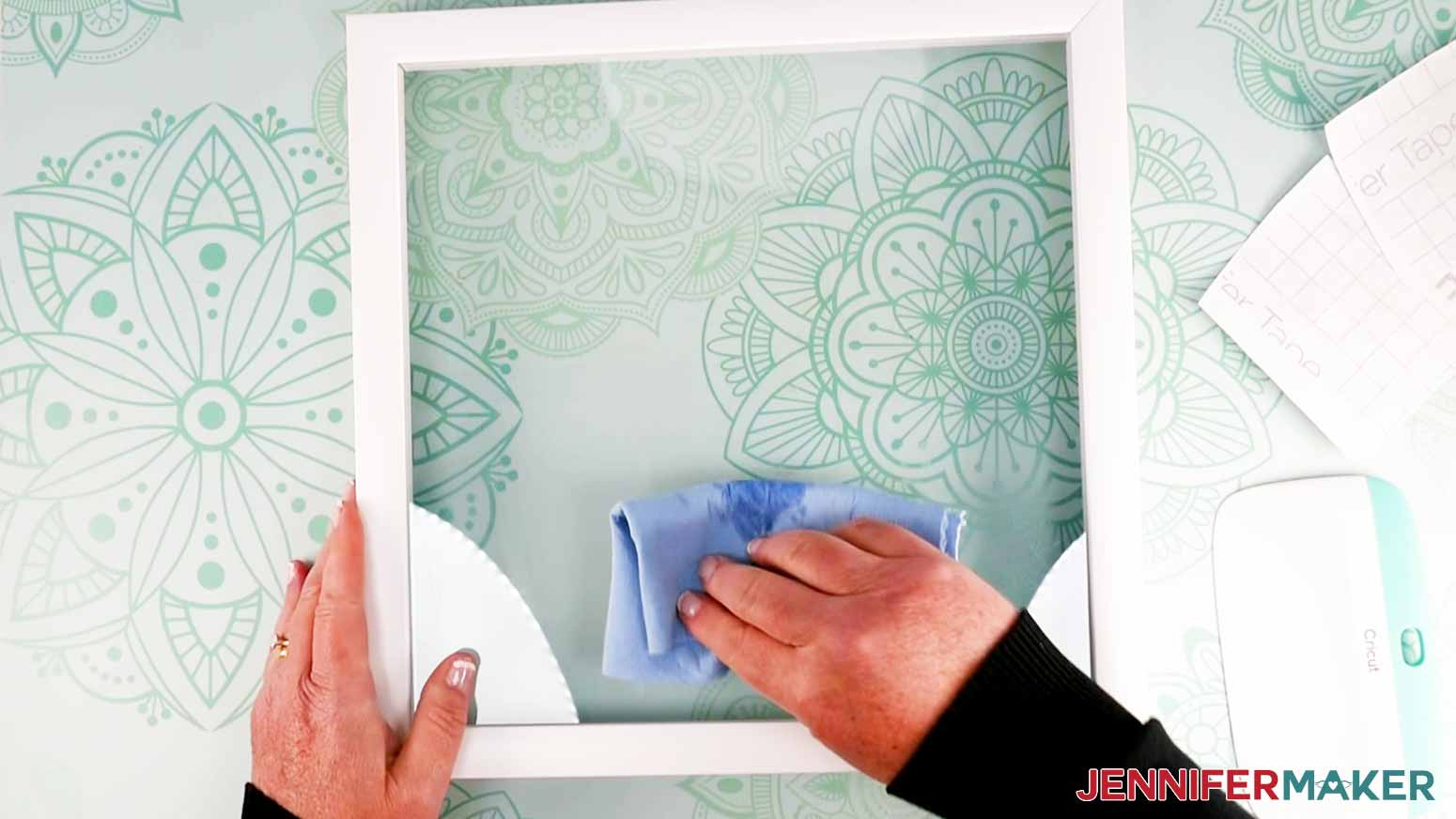 Cleaning the glass of the frame for the Layered Sea Animals SVGs