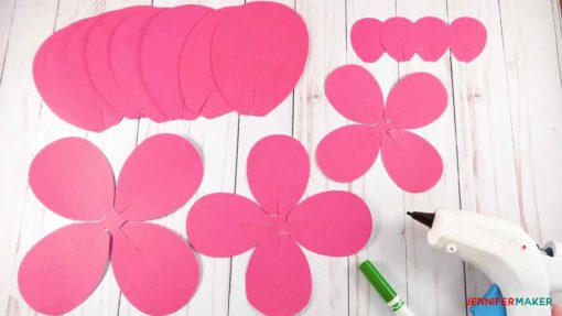 Cut petals, hot glue gun, and a marker to make giant paper flowers