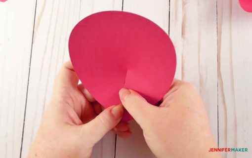 Cupping the large pink paper petal