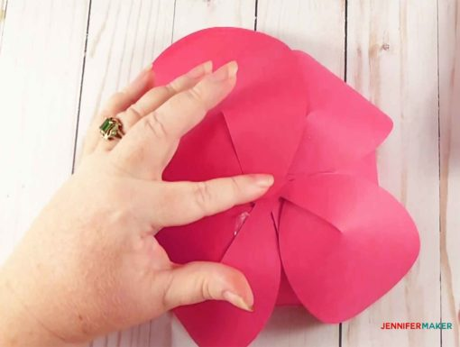 Glueing large petals to the bottom of the giant paper flower