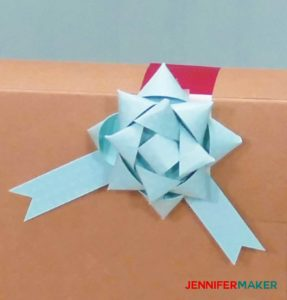 A small blue paper bow made with a Cricut