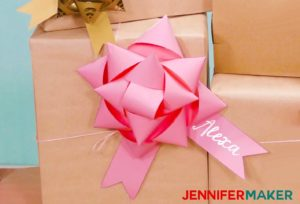 A big pink paper bow made with a Cricut
