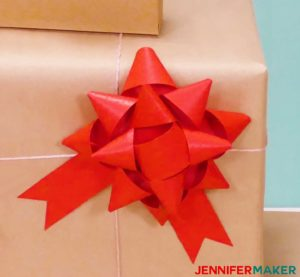 A red paper bow made with a Cricut