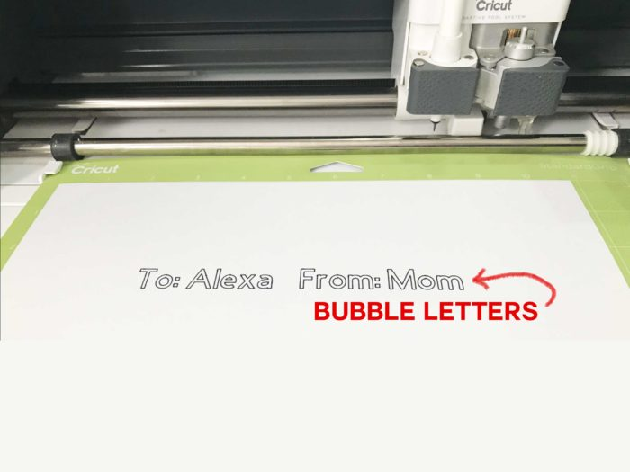 The dreaded bubble letters made by a Cricut pen when preparing gift tags on a Cricut