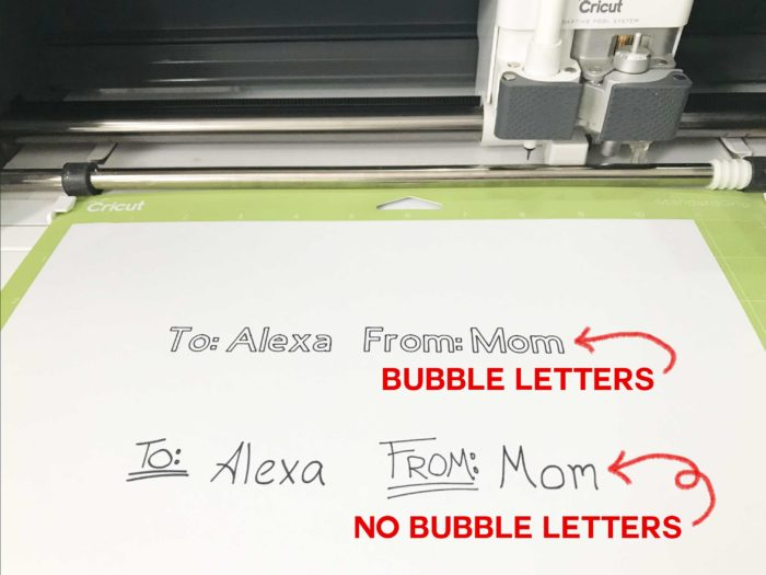 A bubble letter font and a handwriting font made by a Cricut pen in preparing Cricut gift tags