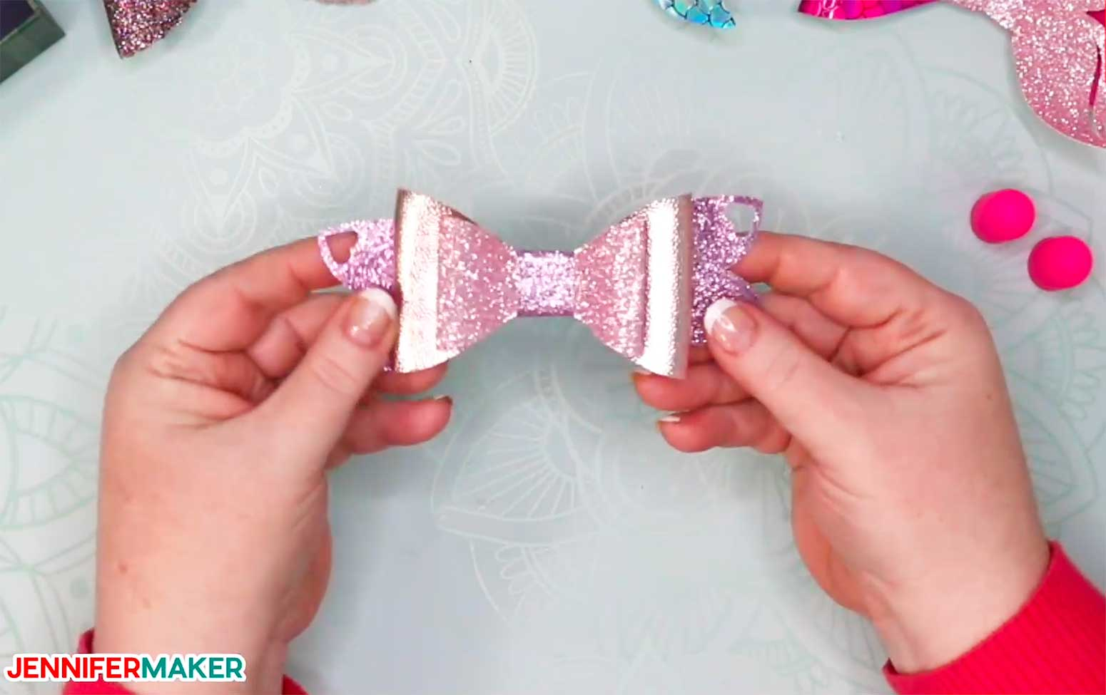 A pink glitter faux leather hair bow made on a Cricut!