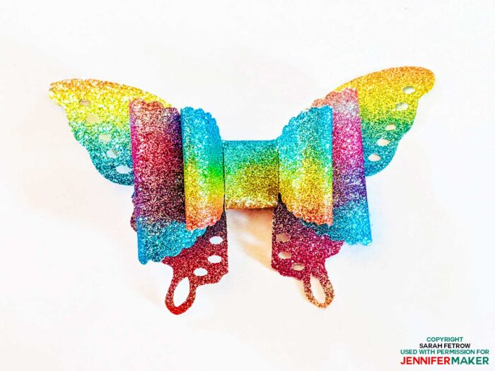 Rainbow faux leather butterfly hair bow cut on a Cricut by Sarah Fetrow (photo used with permission)