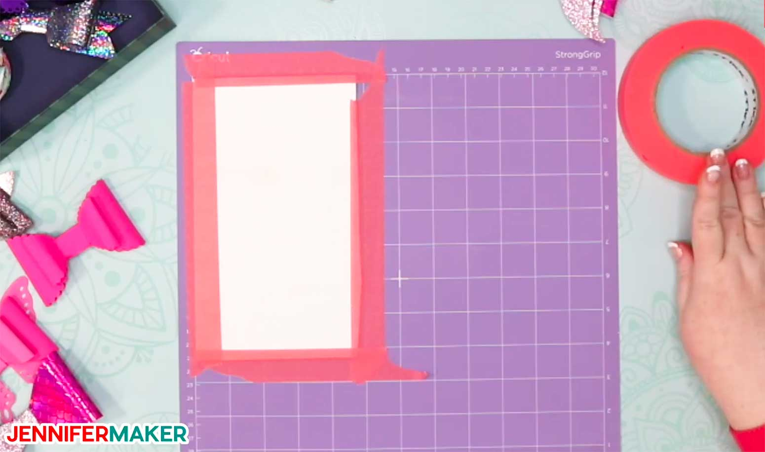 Place faux leather face down on a purple StrongGrip mat and tape around the edges to make faux leather hair bows