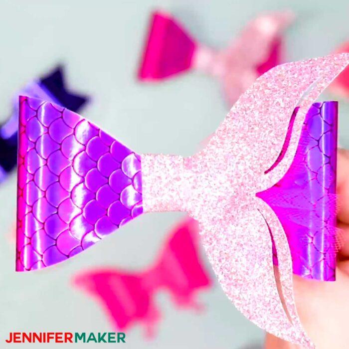 A purple faux leather mermaid tail hair bow made on a Cricut