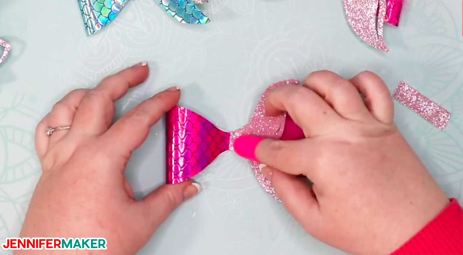 Gluing a faux leather mermaid tail to make hair bows