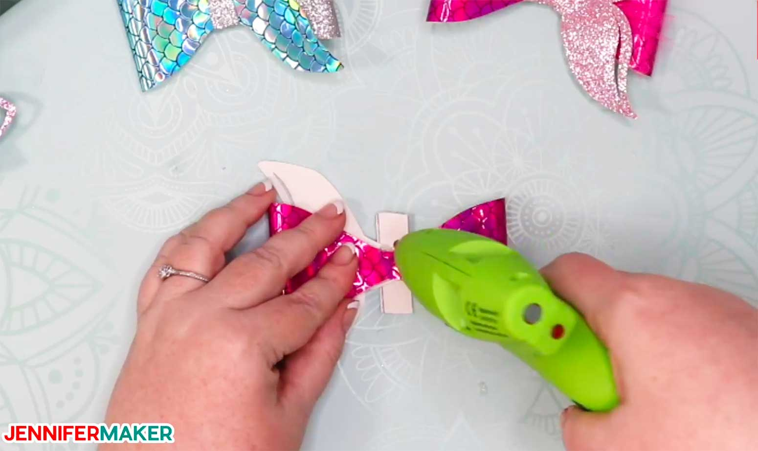 Gluing the band onto the mermaid tail hair bow