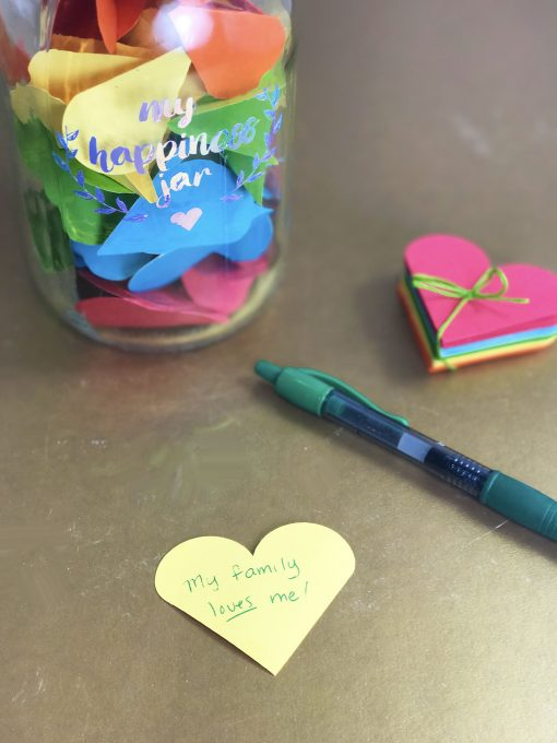 Writing a note for my happiness jar