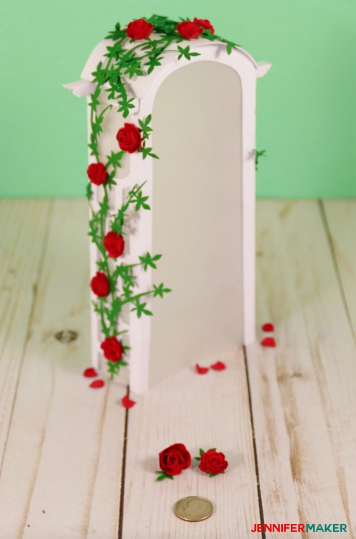 Two dozen miniature paper roses on a paper arbor arch
