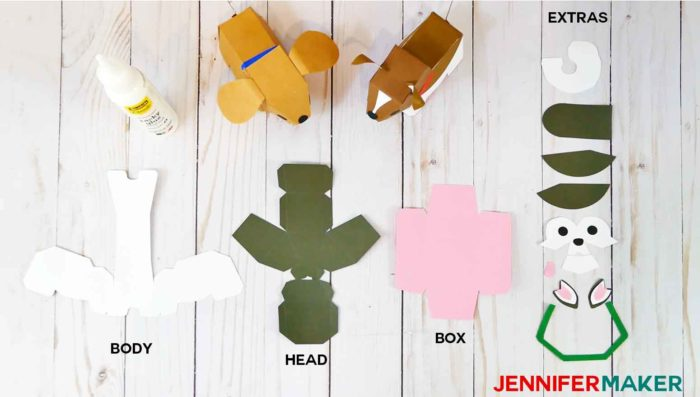 The paper pieces and materials you need to make paper dog boxes
