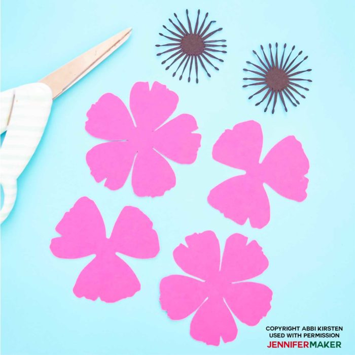 Cut pieces of pink paper to make paper poppies