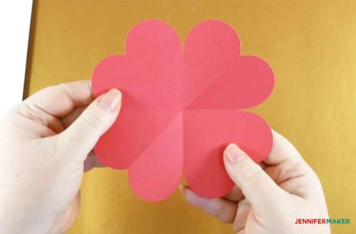A scored and folded heart piece ready to make the pop-up heart card