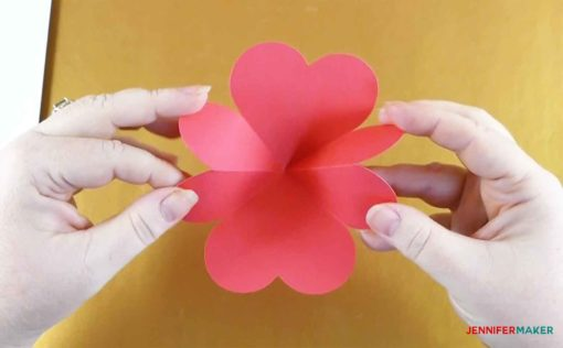 Folding the heart piece into itself to make the pop up heart rainbow card