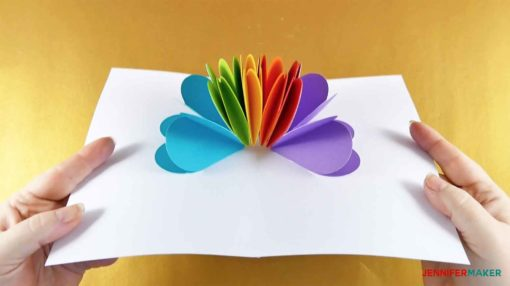 Opening up the pop-up heart rainbow card