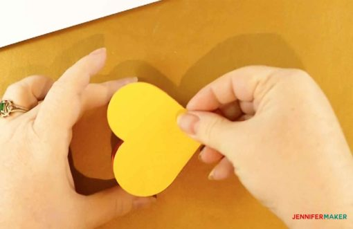 Placing a heart on top of a glued heart