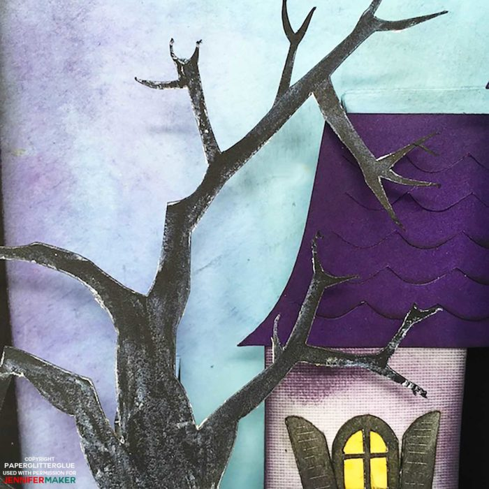 Using white crayon to distress a black tree for a Halloween Manor pop-up card