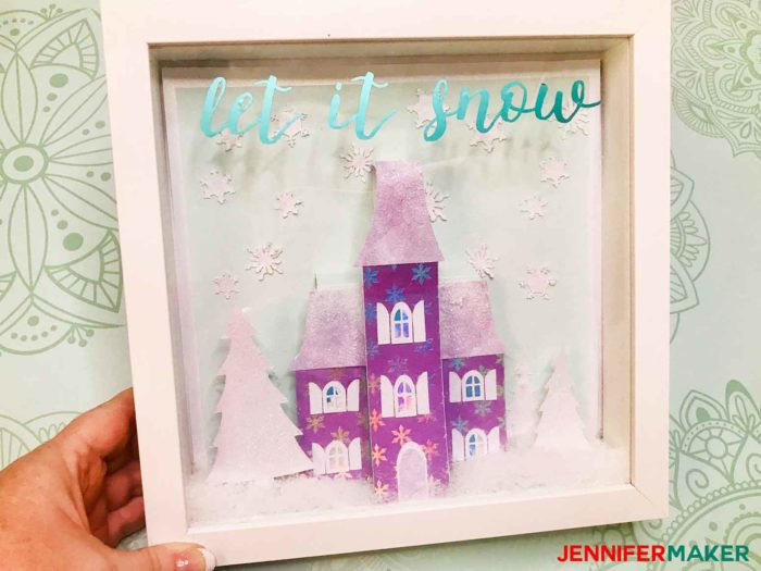 Shadowbox with a paper Holiday Manor house and lots of glitter