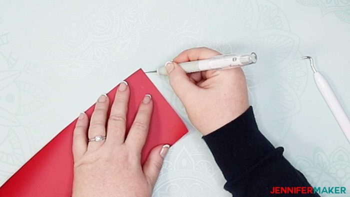 Cutting a corner in a piece of iron-on vinyl to make it easier to weed