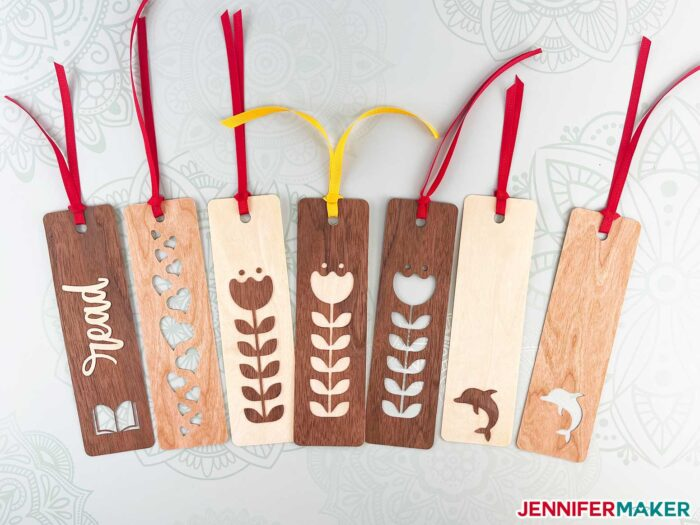 Wooden bookmarks in walnut, cherry, and maple wood veneers with hearts, flowers, books, and dolphins