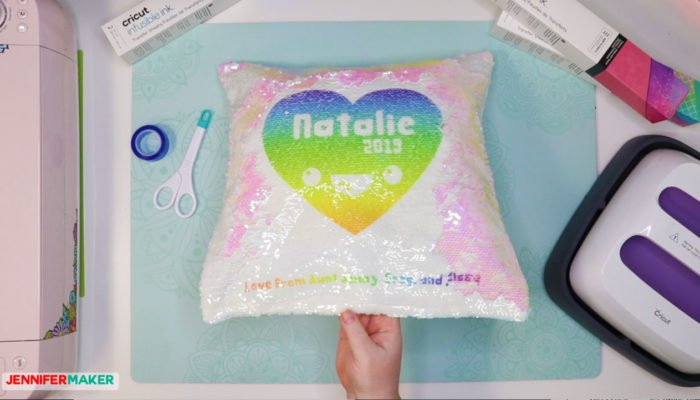 Mermaid sequin pillow with a Cricut Infusible Ink transfer of a rainbow heart on it