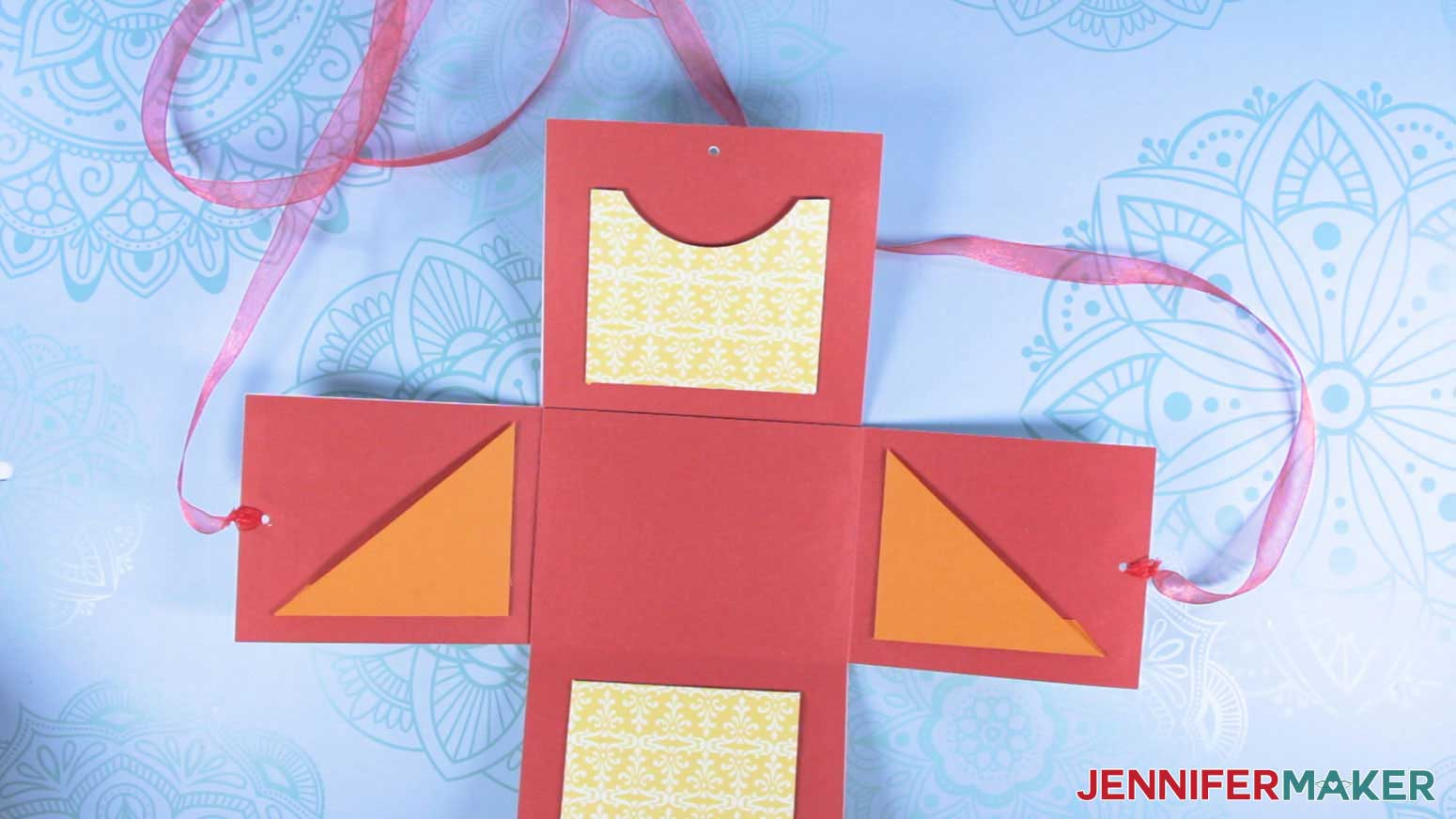 Attach ribbon to the explosion mug gift boxes