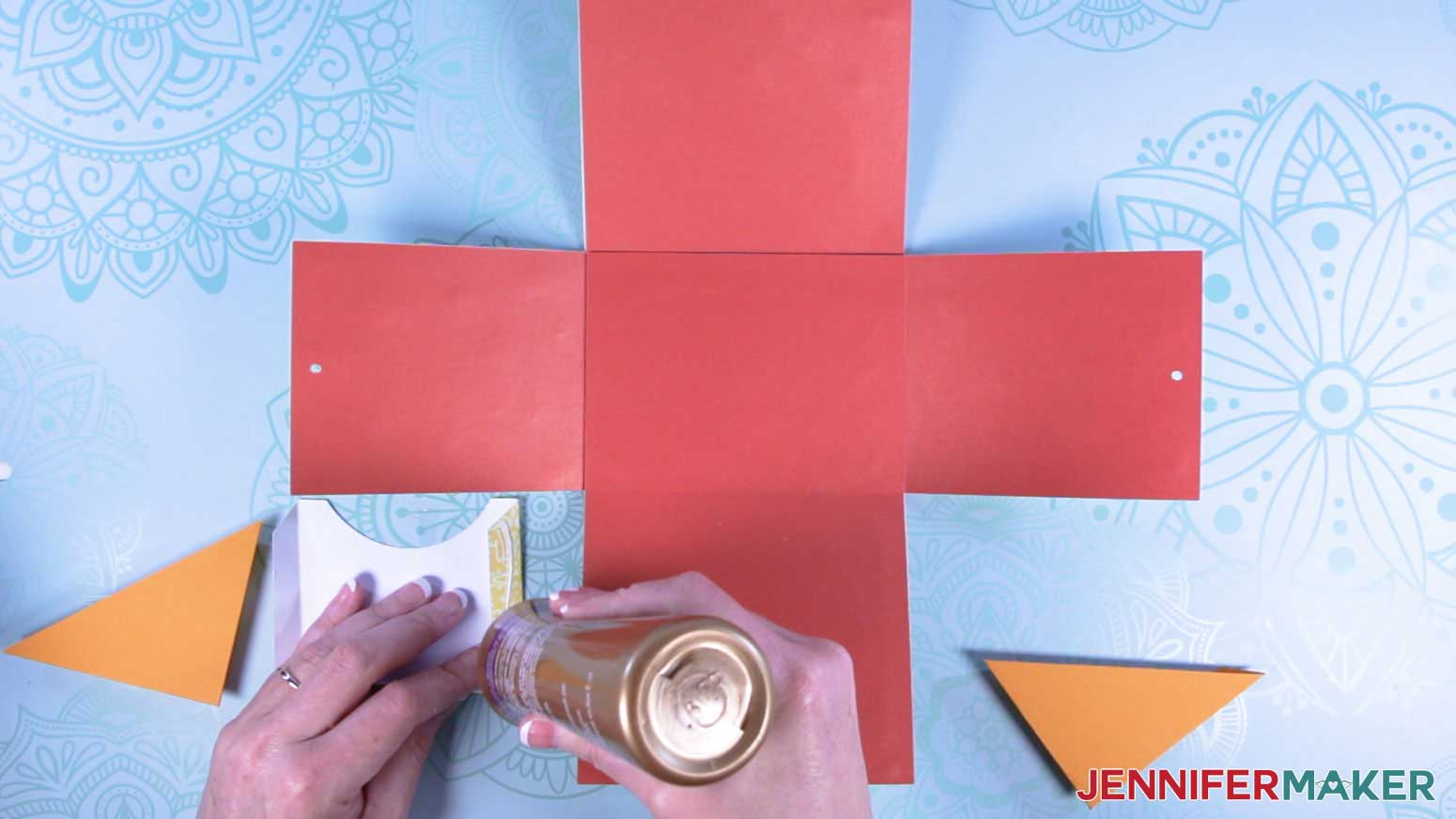Apply glue to the tabs of the pockets of the explosion mug gift boxes