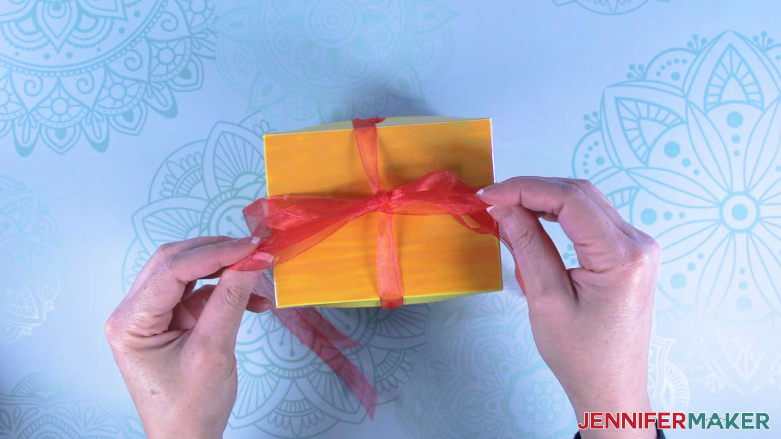 Tie bow on top of explosion mug gift boxes
