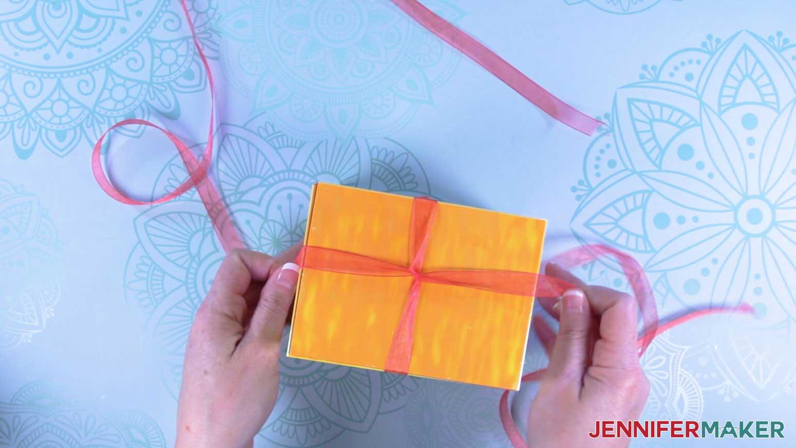 Wrap ribbon around explosion mug gift boxes