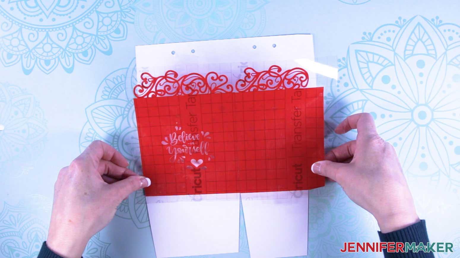 Align the decorative vinyl wrap to the milk carton gift box