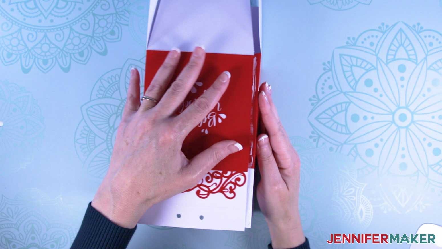 Attach the milk carton mug gift box sections to enclose the box