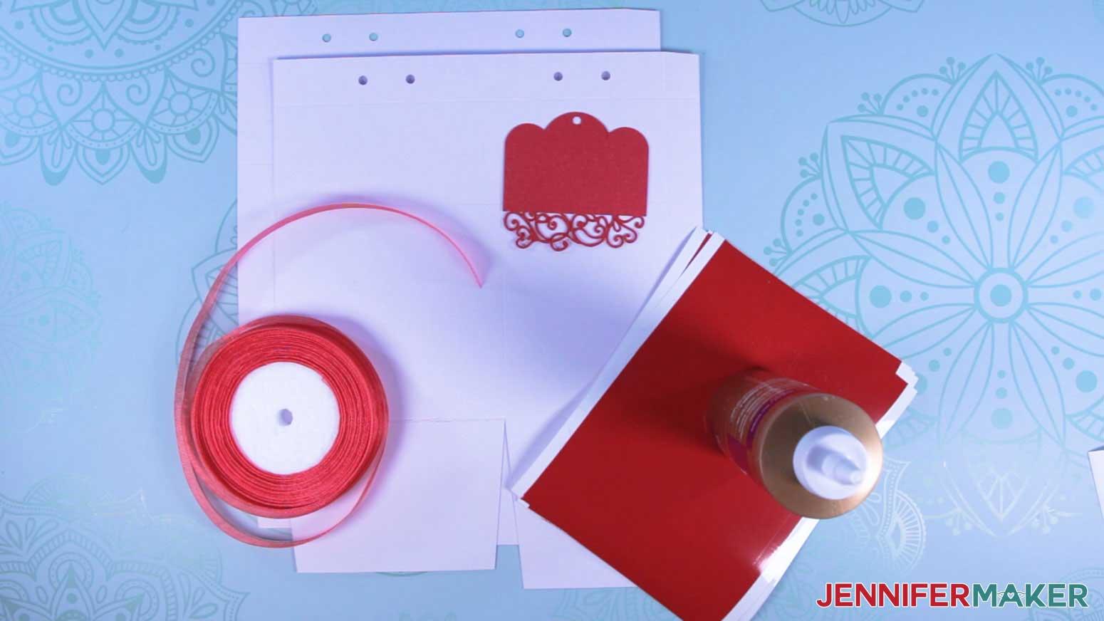 Materials used to make a milk carton mug gift box with a decorative vinyl wrap
