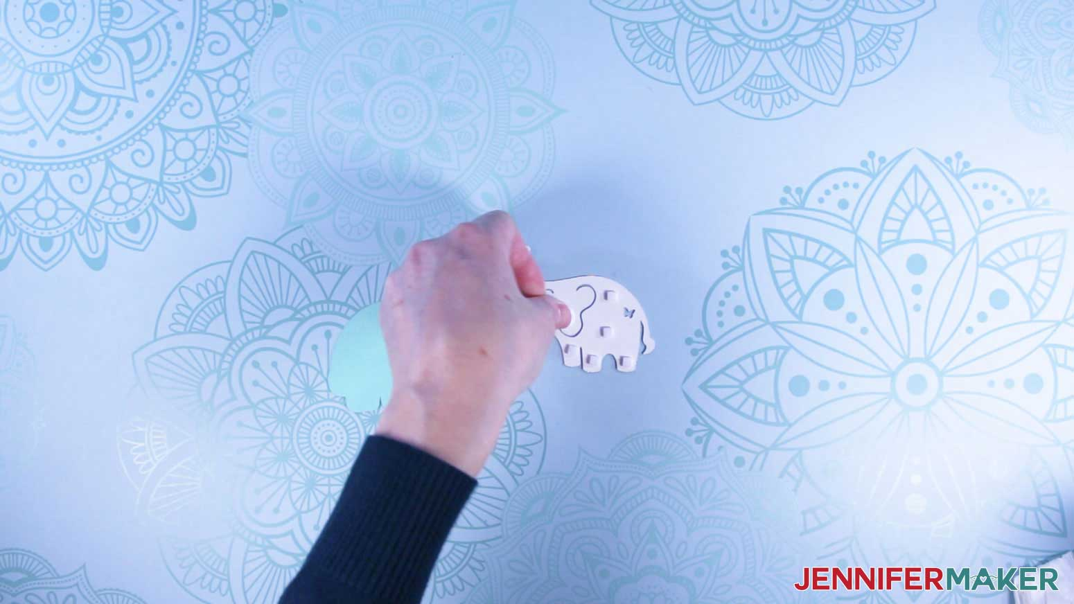 Attaching 3D tape to elephant topper for the mug gift boxes