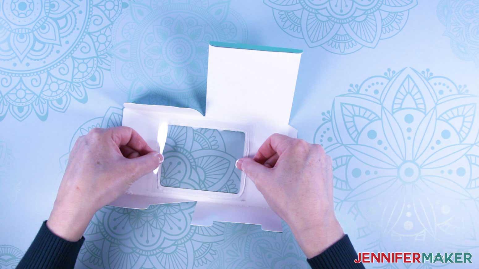 Attach acetate window to mug gift box