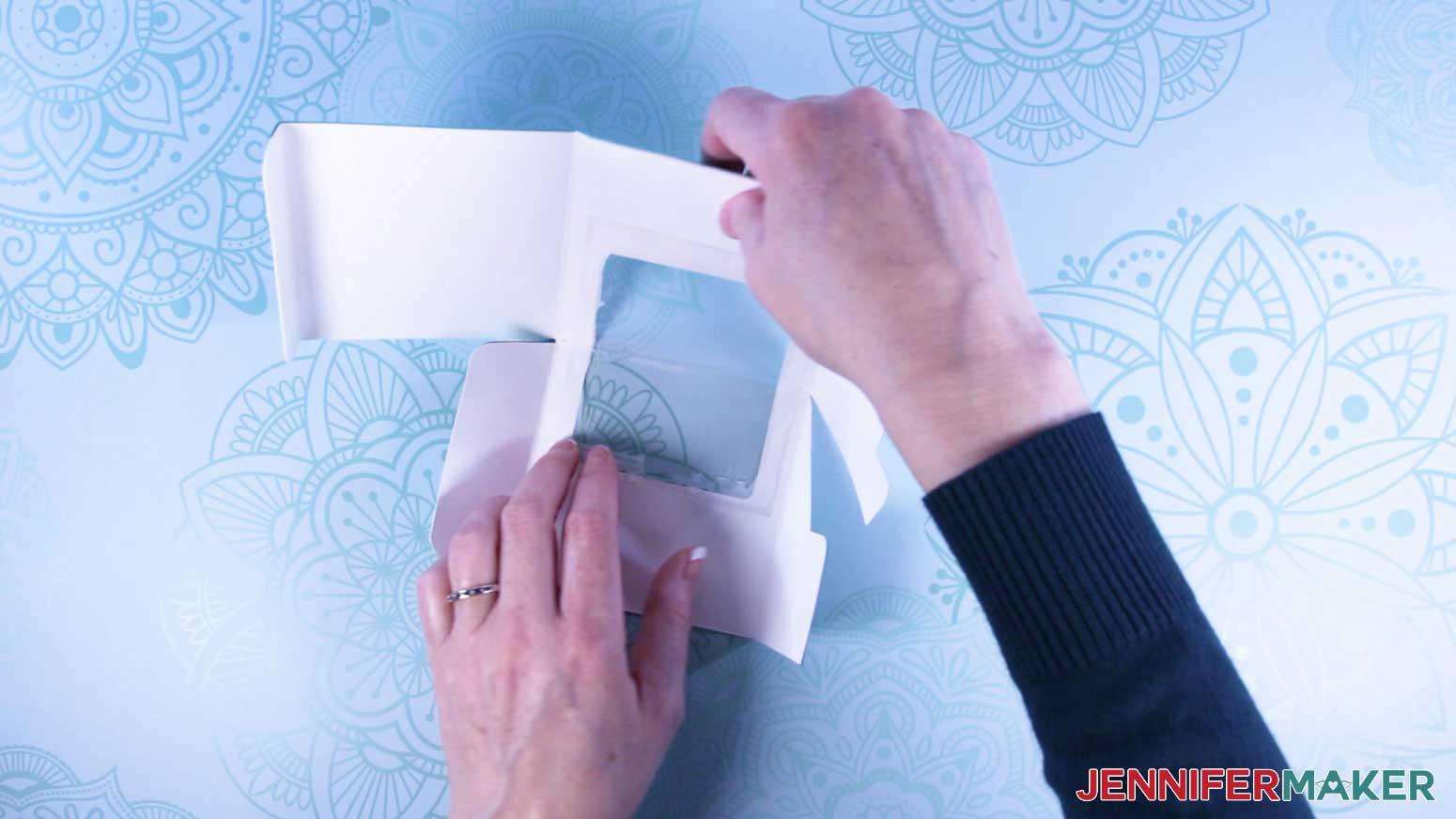 Carefully fold corner acetate window of mug gift boxes