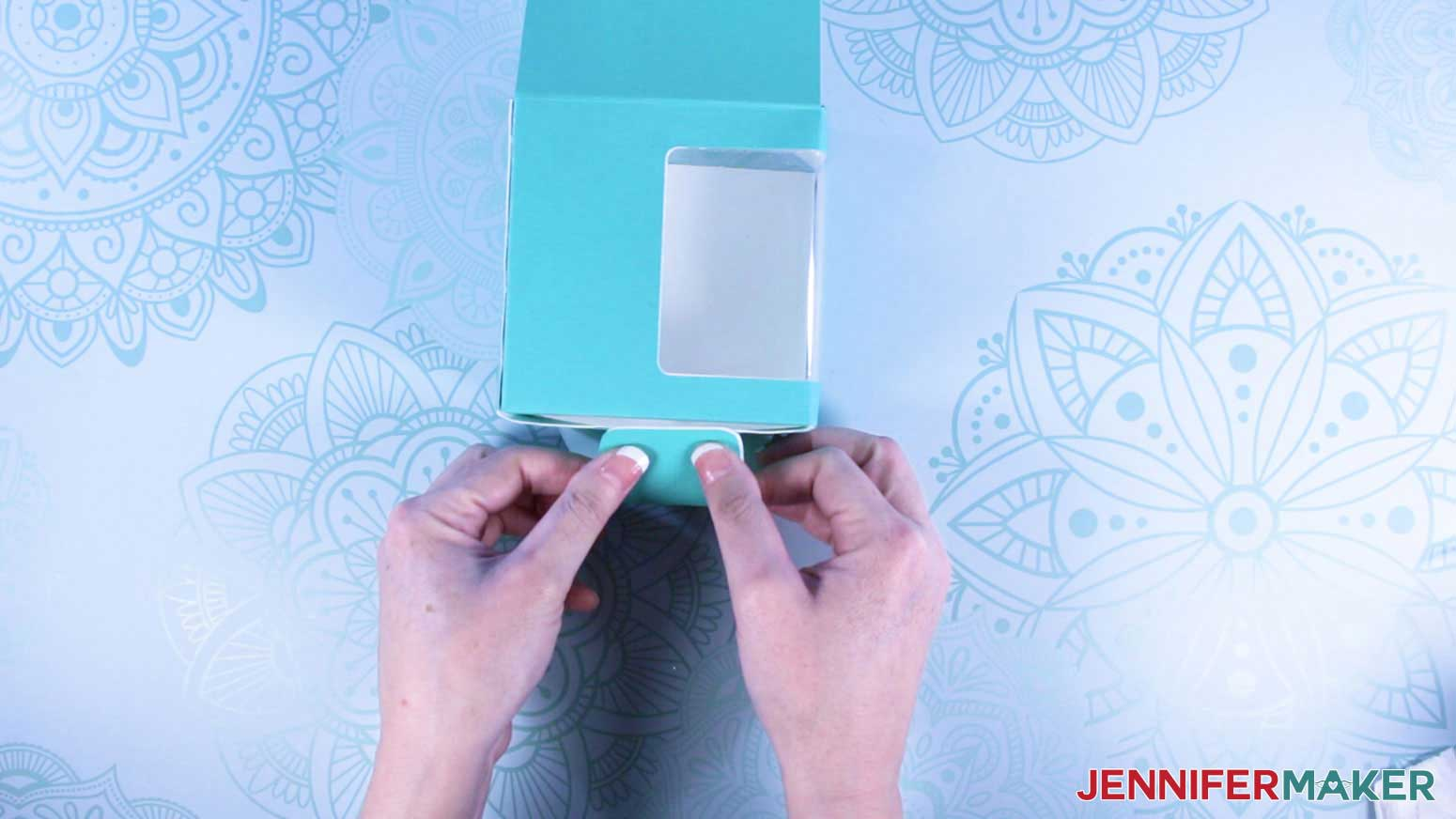 Folding in bottom flaps of mug gift boxes with a window