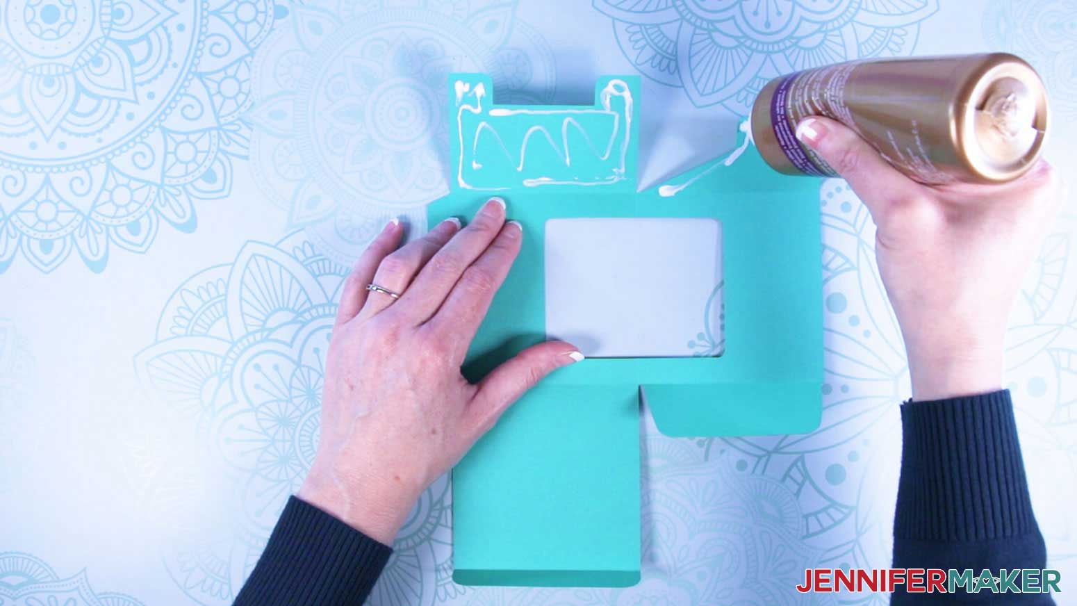 Apply glue to decorative cardstock layer of the mug gift box with a window